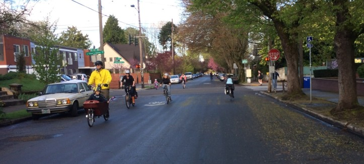 Picture of bicyclists riding on bike boulevard through an intersection